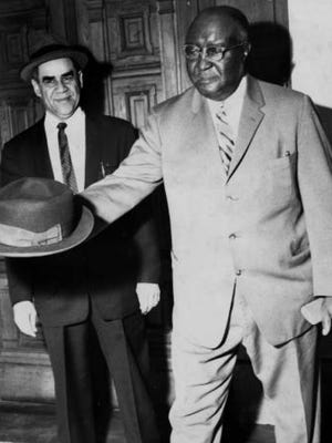 Frank Beckwith (right) throws his hat into the ring as a presidential candidate in 1960.