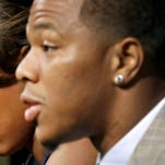 FILE - In this May 23, 2014, file photo, Janay Rice, left, looks on as her husband, Baltimore Ravens running back Ray Rice, speaks to the media during a news conference in Owings Mills, Md. The offender-rehabilitation program that former Ravens player Rice entered after knocking Janay unconscious in an Atlantic City elevator is rarely used in domestic assault cases. (AP Photo/Patrick Semansky, File)