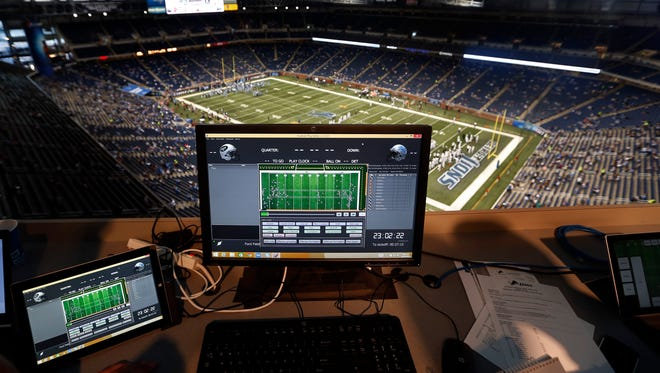 A monitor above Ford Field shows statistics and movement for players and officials during warmups Aug. 13, 2015, in Detroit.