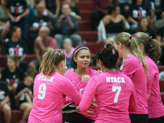 Maya Owens, center, with her teammates during volleyball