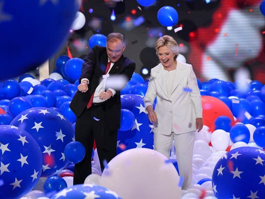 Balloons fall as Hillary Clinton and Tim Kaine stand