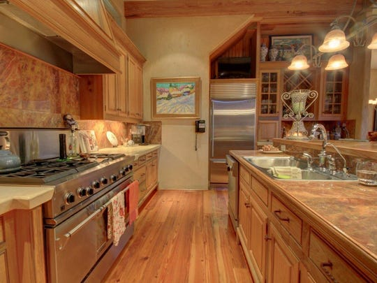 Gorgeous kitchen has all the best for any gourmet cook.