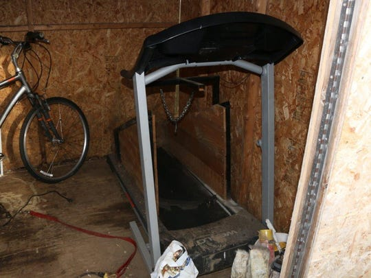 A treadmill with a chain on it where police believe suspects were running fighting dogs.