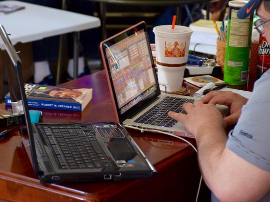 Mike Hevener keeps track of his fantasy baseball league's annual draft in Staunton on April 2.