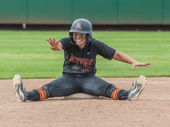 Aztec's Kylie Brown sits on second base during a break in the action against Centennial in a state championship game on May 14 in Albuquerque.