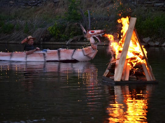 Creek Fire organizer Clifton Santiago made a dragon boat out of packing material and zip ties for the illuminated art boat parade at an event during the 2015 season. Creek Fire will continue every fourth Saturday through September.