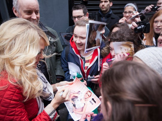 Carrie Underwood signs autographs for fans in Ireland.