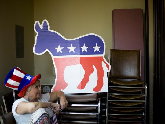 Pamela Brager sits to watch a speech during the DNC at a watch party in Naples on July 28, 2016.