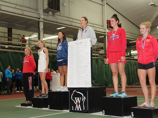 For the second straight year SPASH's Emily Luetschwager stood atop the podium at the Nielsen Tennis Stadium as the WIAA Division 1 state singles champion.