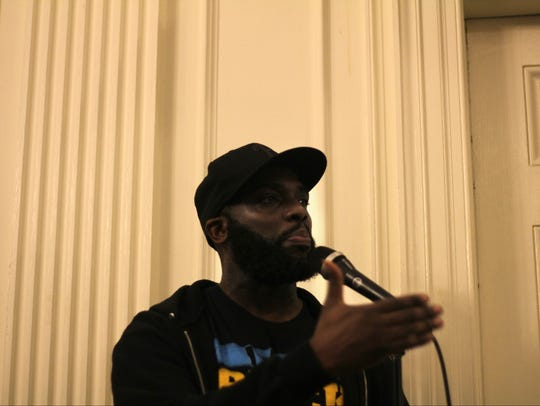 Community activist Tormel Pittman speaks at a New Brunswick