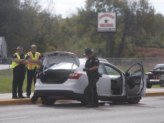 Greene County deputies investigate a vehicle involved in a pursuit on Kansas Expressway near Mt. Vernon Street.