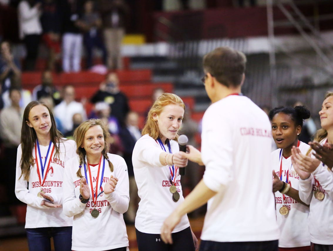 Coach Tim Holman celebrates with team members Kendall Eatherly, left to right, Jordan Grants, Emma Kuntz, Mye' cia Bright, and Taylor Boggess during a pep rally celebrating their recent state championship win. November 9, 2016