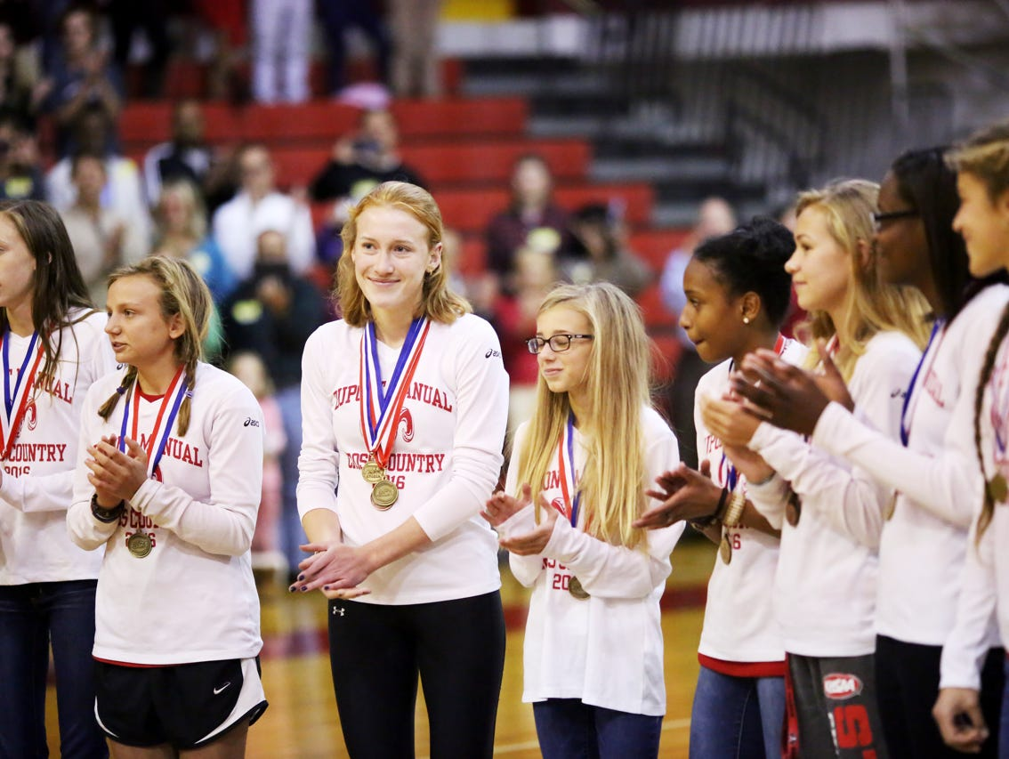 Cross country team members, left to right, Kendall Eatherly, Jordan Grants, Emma Kuntz, Kati Hoerig, Mye' cia Bright, Taylor Boggess, Kennedy Duncan, and Alena Sapienza-Wright celebrate the recent cross country state championship win during a pep rally. November 9, 2016