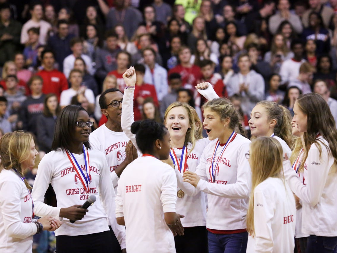 Cross country team members celebrate the recent cross country state championship win during a pep rally. November 9, 2016
