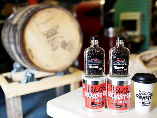 Red Hot Roasters recently started selling bourbon barrel-aged coffee beans at their store on Lexington Avenue. Red Hot Roasters has their dark roast organic coffee, bourbon barrel-aged coffee beans, and togo coffee cups for sale at their store. 