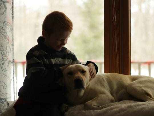 Dylan Weese, 6, plays with Pixie.
