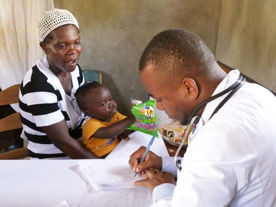 A woman takes her baby for a check-up at one of the