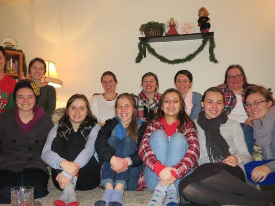 Rachel Kuenzi, a teacher at Englewood Elementary school, organizes young women from her church to carol every year.
