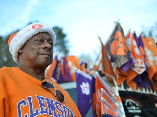 William Cleveland, 60, came to Clemson University Tuesday afternoon to welcome the Tigers home. The Walhalla resident has 52 Clemson flags on his Ford Escape, and said occasionally people stop and ask him if his flags are for sale.