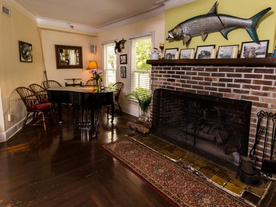 The Tarpon Lodge still has its original 1926 flooring and fireplace.