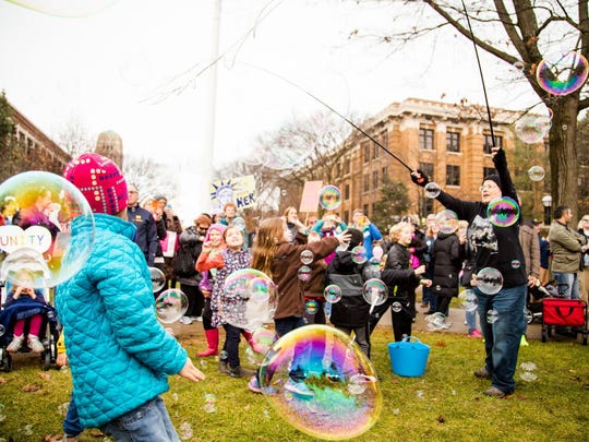 Kids play with bubbles during the Women's March in Ann Arbor on Jan. 21, 2017.