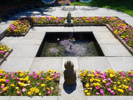 Rectangular beds are featured around a sunken pool at West of the Lake Gardens in Manitowoc.  A gentle fountain adds sound that separates this space from the rest of the garden. The choice to fill the planting area with a single plant species was a popular feature of modernist gardens.