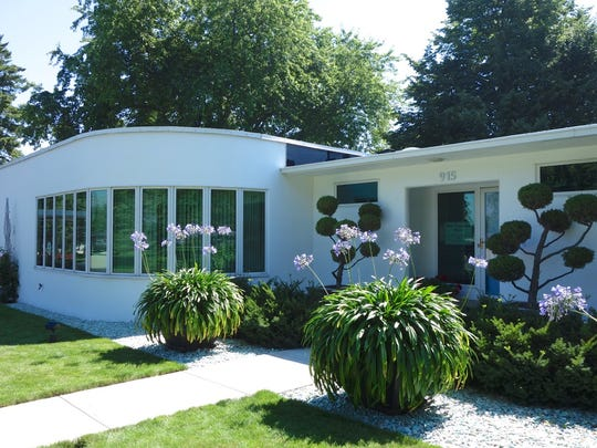 John West and Ruth St. John built their Bauhaus-inspired home in Manitowoc in 1934.  St. John called her surrounding landscape West of the Lake Gardens.