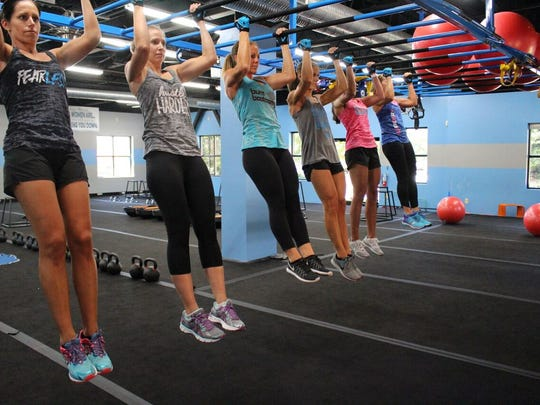 Women work out at a Burn Boot Camp location.