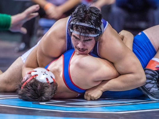 Piedra Vista's Adrian Tarwater, top, pins Las Cruces' Zayne Alley during the 6A state championships on Friday at the Santa Ana Star Center in Rio Rancho.