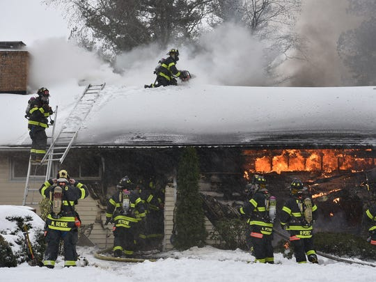 Firefighters battled the wind, snow and cold while the knocked down the blaze.