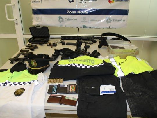 A Juárez transit police uniform, gear and firearms were seized during a drug raid Wednesday in Juárez.