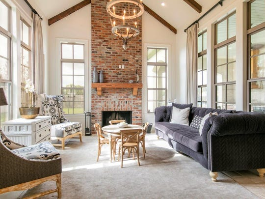 The living area features cathedral ceilings and huge custom windows.