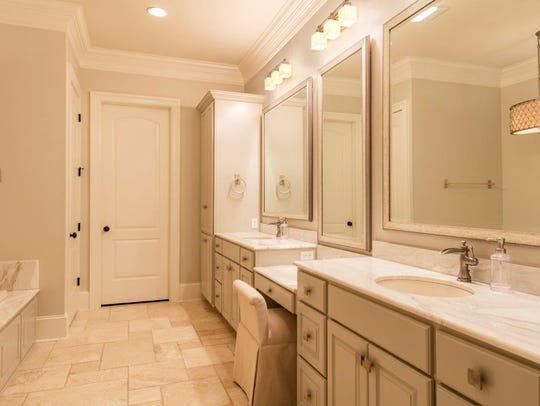 The master bath has soothing tones and plenty of storage.