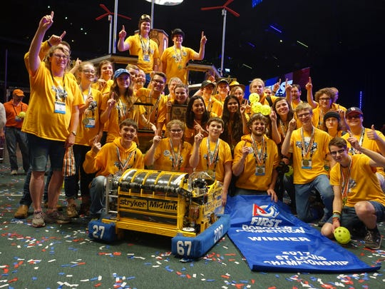 The Stryke Force robotics team from the Kalamazoo area poses for a group shot after being part of the four-team alliance that won the world championships in St. Louis April 29.