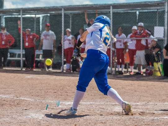 Bloomfield's Madison Mayo drives in the winning run against Valencia on Thursday at Cleveland High School.