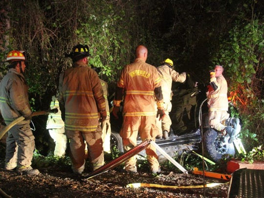 Authorities work at the scene of a fatal wreck Sunday
