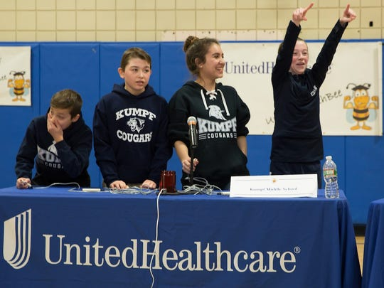 Seventh-graders from Carl H. Kumpf Middle School celebrate adding another point to the scoreboard, leading to their victory at the 2017 UnitedHealthcare Health Bee competition in Scotch Plains. From left: Vincent Benevento, Matt Brophy, Danae Arbello and Anna Ninashvilli.
