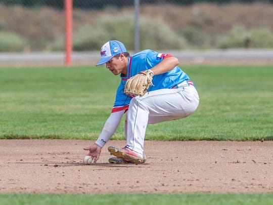 D-BAT Elite's Jimmy Glowenke fields the ball before throwing to first for an out against the Midland Redskins on Saturday at the Farmington Sports Complex.