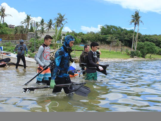 Six young spearfishermen head out to see what the ocean