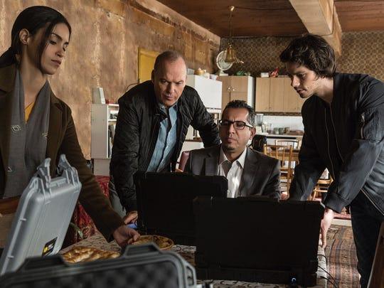 "Shiva Negar, Michael Keaton, Neg Adamson and Dylan O'Brien in ""American Assassin."""