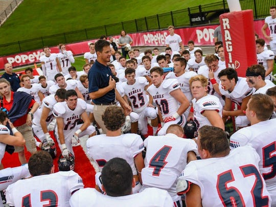 New Teurlings Catholic coach Dane Charpentier gives postgame speech to his Rebels after last week's jamboree win over Cecilia at Cajun Field.