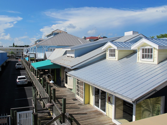 Brookline Cos. purchased the Dockside Boardwalk in Naples and a neighboring building for $6.5 million on Aug. 29, 2017.