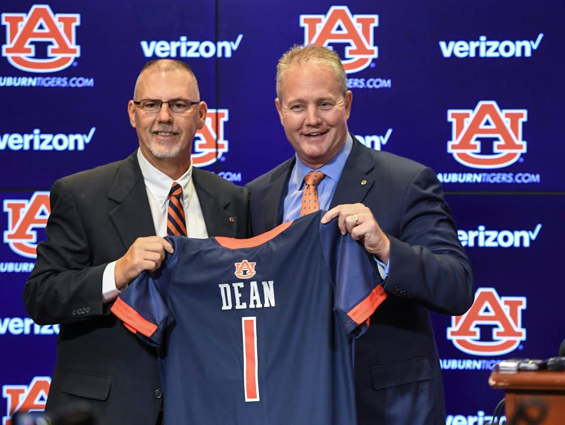 New softball coach Mickey Dean (left) being introduced by Auburn Athletics Director Jay Jacobs (right) on Sept. 17, 2017.