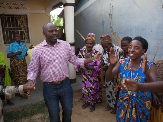 "Twesigye Jackson Kaguri meets with women in the ""Grannies"