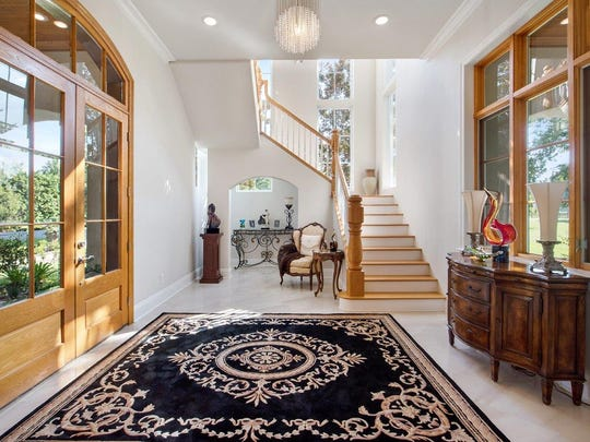 The formal entrance is elegant and welcoming.