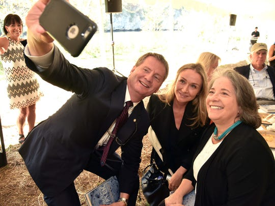 Knox County Mayor Tim Burchett, left, talks a selfie with Alexandra Cousteau, center and Knoxville Mayor Madeline Rogero at the  Legacy Parks annual luncheon at the Seven Islands State Birding Park Friday October 13, 2017.  Alexandra Cousteau, award-winning filmmaker, National Geographic Explorer, and global water advocate, was the featured speaker at the event.  (J. Miles Cary/Special to the News Sentinel)