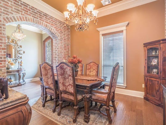 The beautiful entrance leads to a gorgeous formal dining