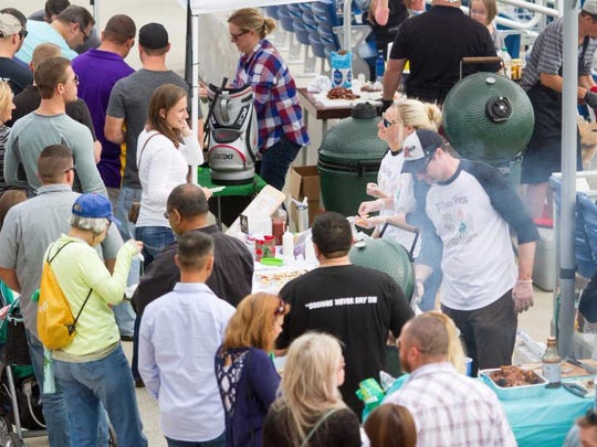 Attendees enjoy the food at a previous Pensacola EggFest. The annual event will return to Blue Wahoos Stadium in downtown Pensacola on Sunday.