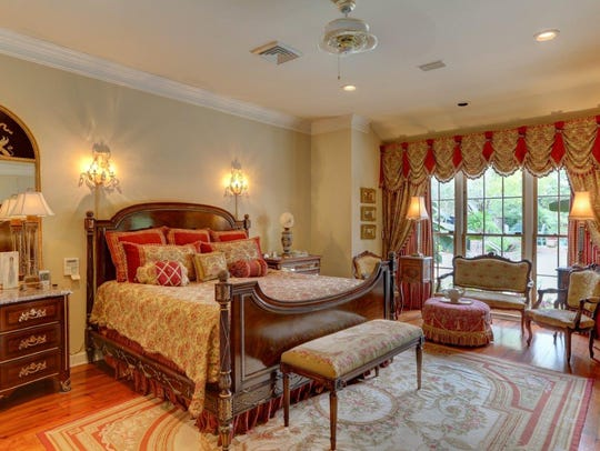 The master bedroom and bath are fit for a king or queen.