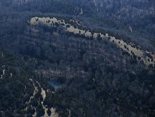 An aerial view shows a tall bluff at Ozark Mountain State Park, which remains closed while park officials decide what to do with the land.